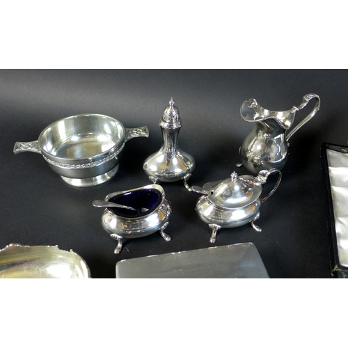25 - A group of silver and silver plated items, comprising a pair of silver weighted dwarf candlesticks, ...