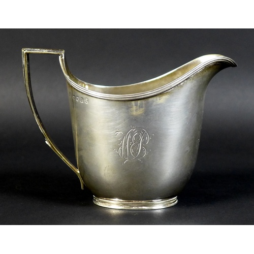 15 - A George III silver milk jug, of helmet form with reeded rim and handle decoration, monogram engrave...