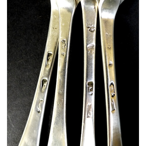 55 - A collection of four early 18th century silver tablespoons, comprising a Queen Anne dog nose spoon, ...