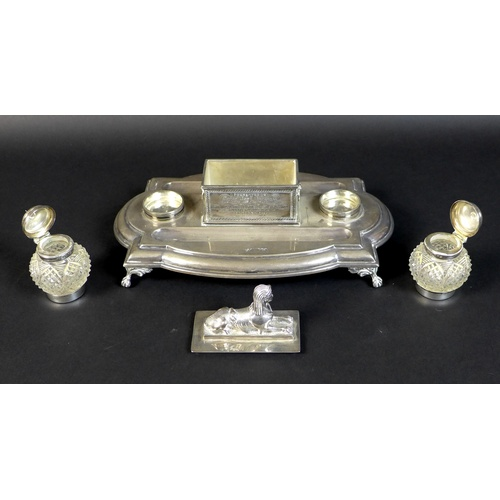 54 - A Victorian silver military presentation inkwell stand, bearing an inscription to its central sphinx...