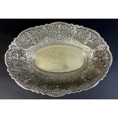 77 - A Chinese white metal pierced bowl of oval form, with floral and foliate applied motifs, the base wi...