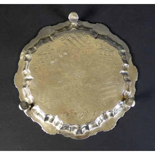 44 - A George II silver waiter tray, of circular form with Chippendale pie crust edge, likely later chase...