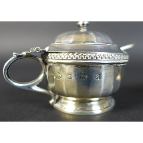 29 - A group of five silver Victorian and Edwardian condiments, comprising a pair of Victorian urn shaped...