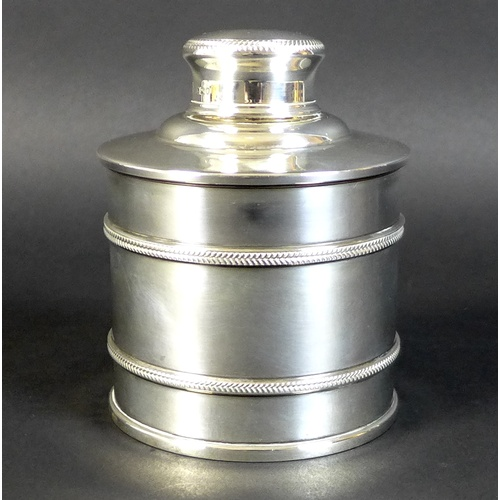 10 - A George V silver dressing table bottle, of cylindrical form with banded body and lift off lid, Edwa...