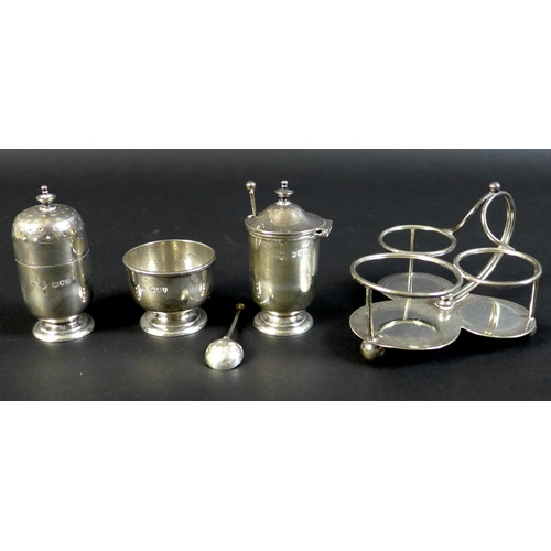 32 - Two silver cruet sets, a Victorian silver set with pepper salt, mustard and pepper pot with trefoil ...