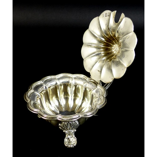 41 - A group of three silver condiment holders, comprising a large Edward VII silver mustard, with hinged...