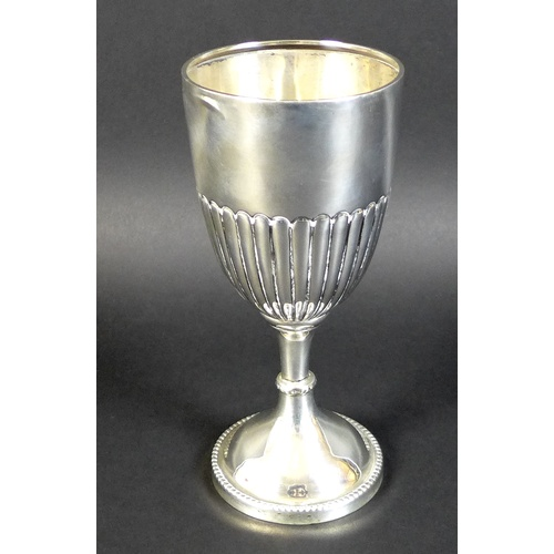 9 - A Victorian silver trophy goblet, with reeded lower body and circular base with beaded decoration, D...