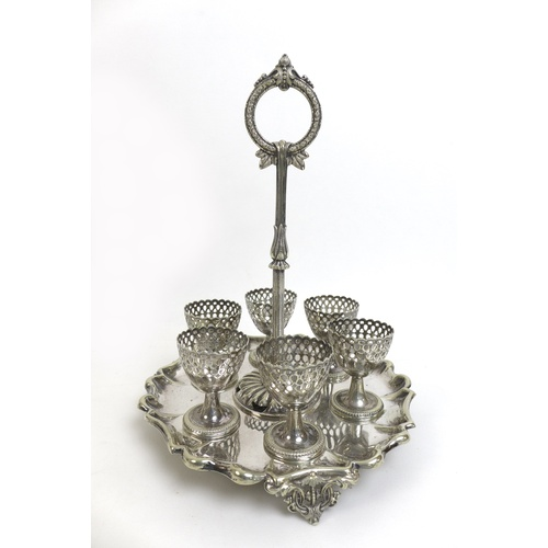5 - A collection of silver plated wares, including a Victorian egg cup stand with six egg cups, 20cm dia...