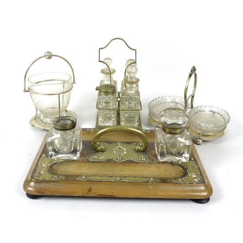 3 - A group of EPNS and glass table items, comprising an engraved glass tea mixing bowl in stand, 11 by ...