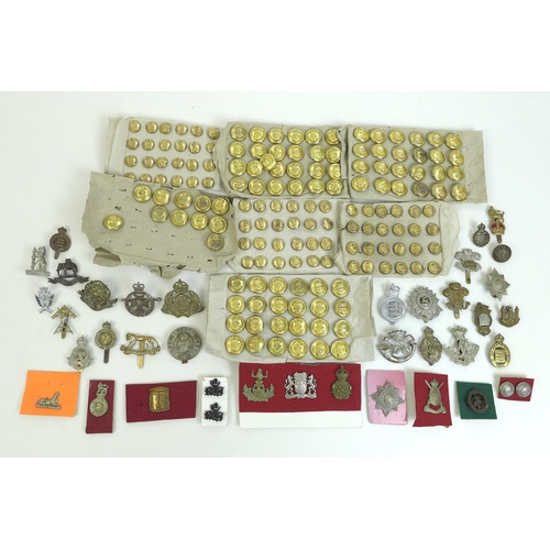 98 - Over one hundred and fifty British army badges and Royal Navy buttons, with approximately forty cap ...