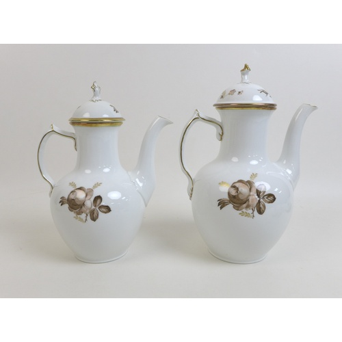 36 - A Royal Copenhagen Brown Rose 688 pattern part coffee set, comprising a coffee pot, tea pot, a sugar...