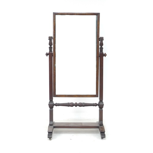 242 - A William IV mahogany cheval mirror, rectangular plate, foliate carved supports, on a rectangular ba...