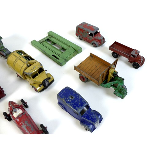 121 - A collection of playworn vintage Dinky model vehicles, including burgundy Rover 75, green Riley, red...