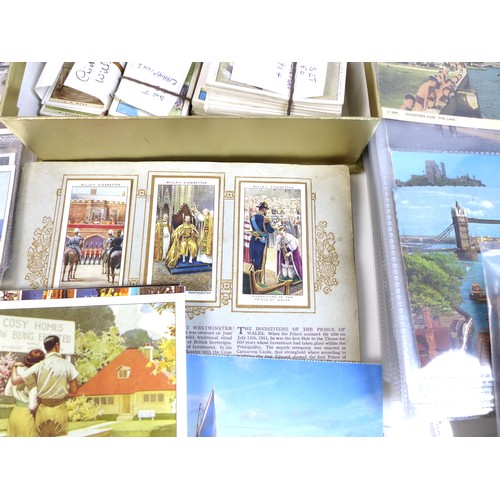 133 - A quantity of GB and World stamps, in nine albums and further loose, together with a collection of v...