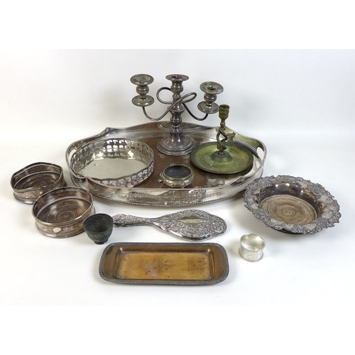 70 - A group of silver plated items, including an oval twin handled tray with pierced gallery, 52 by 36 b...