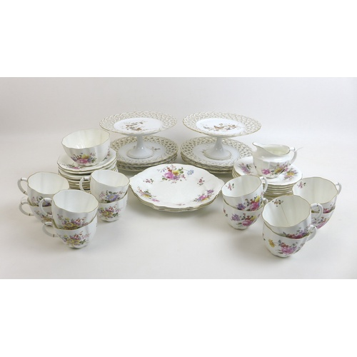 39 - A Royal Crown Derby part tea set in the Derby Posies pattern, comprising twelve tea cups, twelve sau...