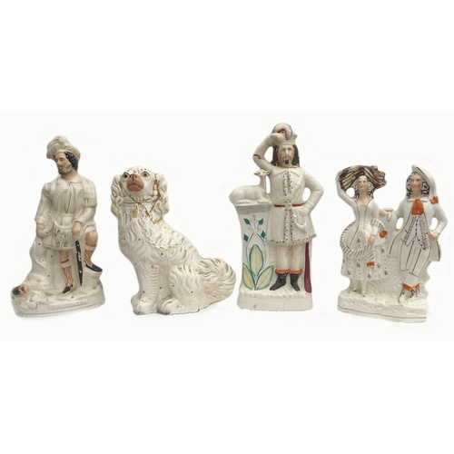 37 - A group of four Victorian flatback Staffordshire figurines, including one titled 'The Lion Slayer', ...