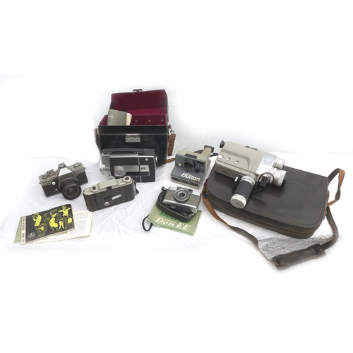 109 - A group of vintage cameras and camcorders, including a Polaroid Instamatic camera, some with origina...