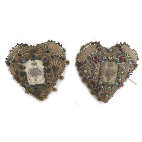 94 - A pair of WWI heart shaped pin cushions, decorated with Grenadier Guard emblem and ornate beadwork, ...