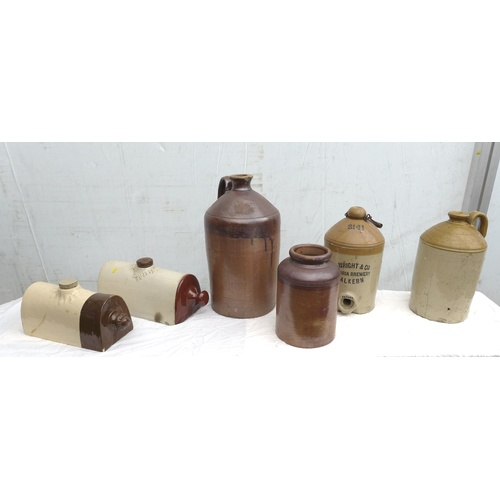 60 - A group of stoneware jugs, including an S. Wright & Co brewery jug, 16cm diameter, 31cm high, and tw...
