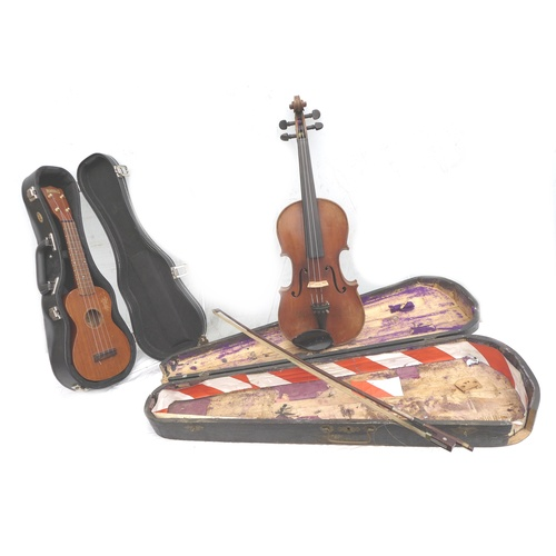 78 - A vintage Mahalo ukulele, together with a full size French violin, back 14