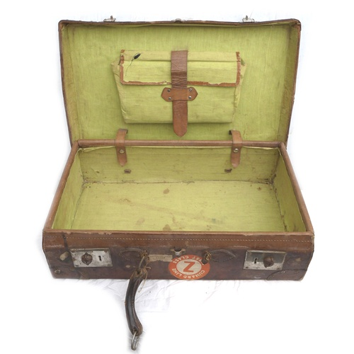 177 - A vintage brown leather suitcase, once belonging to Group Captain I. Thomas of RAF Swinderby, with v...