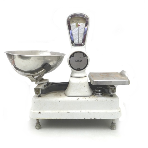 69 - A set of vintage Avery shop scales, in white enamel finish, with original plates, overall 55 by 40 b...