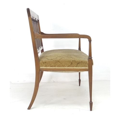 238 - An Edwardian mahogany crossbanded and line inlaid two seater settee, lattice column splat back, over...