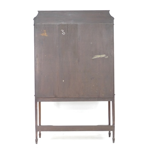 232 - An Edwardian mahogany crossbanded and line inlaid display cabinet, twin glazed doors enclosing two s...