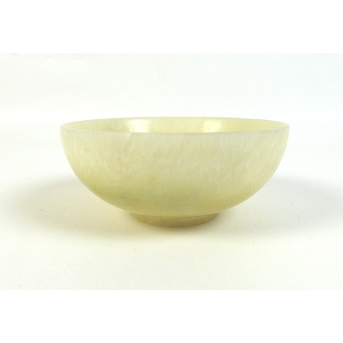 13 - A Chinese mutton fat jade bowl, 11 by 4.5cm, together with a pale green and white jade bangle, 6cm i...