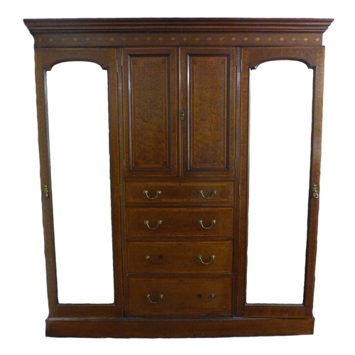 225 - An Edwardian mahogany compactum wardrobe, with inlaid and crossbanded decoration, outswept cornice o...