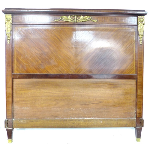 240 - A French early 20th century double bed frame, veneered and gilt metal mounted, consisting head board...