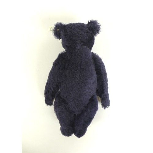 114 - A 1998 Steiff replica 1909 dark blue teddy bear, 35cm high with growler, a certificate numbered 2623...