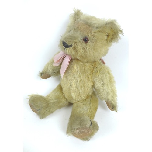 112 - A circa 1930s Chad Valley blonde teddy bear, with 'Hygenic Toys Chad Valley' label to underside of l...