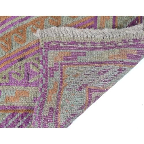 198 - A Gazak rug, with orange, purple and light green diamond shaped decoration, latch hook edges, 117 by...
