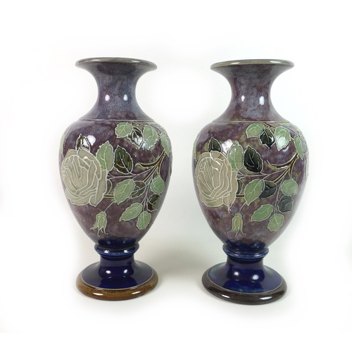 45 - A near pair of Royal Doulton stoneware 'Roses' pattern vases, of baluster form, with rose decoration...