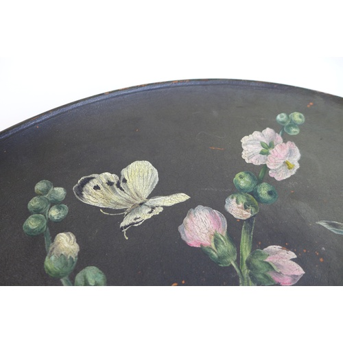 44 - A large Watcombe Torquay ware terracotta plate, hand painted with hibiscus flowers and insects, sign...