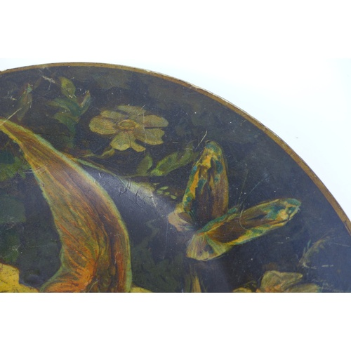 47 - A Victorian paper mache plate, depicting a tropical bird with open wings, surrounded by folliage, 32...