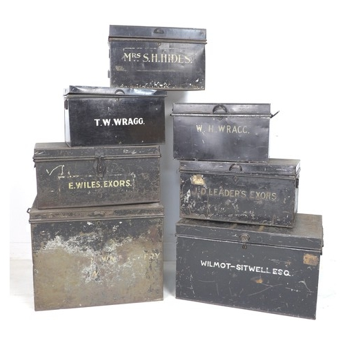 175 - A collection of seven early 20th century metal deeds boxes, each painted black with white owner's le...