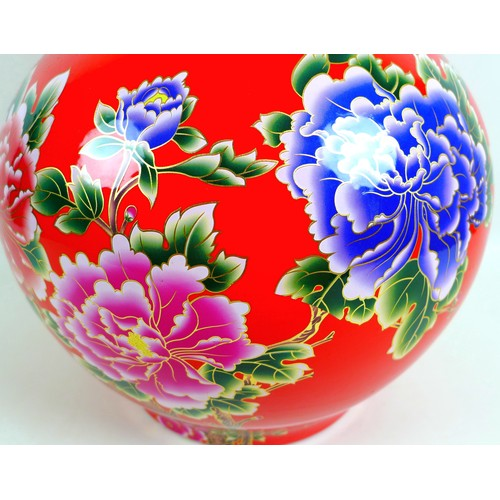 15 - A large modern Chinese porcelain double gourd vase, with printed floral decoration against a red gro...