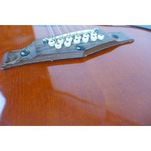 88 - A 1970s Eko Ranger 12 twelve string acoustic guitar, with spruce top, and block pearloid inlaid rose...