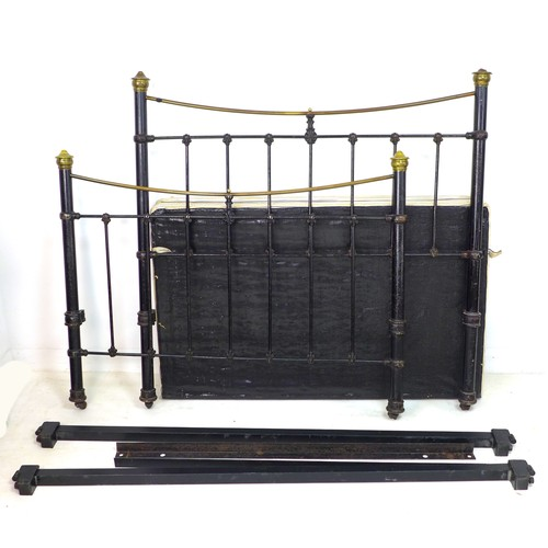 237 - A Victorian brass and iron double bed frame, with brass ball finials and black painted spindle rail ...