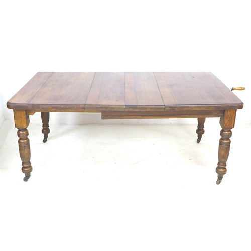 227 - A late Victorian oak extending dining table, with two additional leaves, 29cm and 30cm, carved balus...