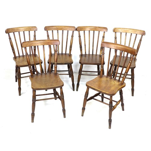 228 - A set of six Victorian oak stick back Windsor dining chairs, with shaped seats and turned legs joine...