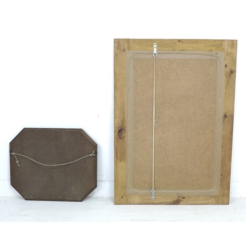 217 - Two modern wall mirrors, with wooden frames, larger with rectangular plate, 80 by 3.5 by 109cm, the ...