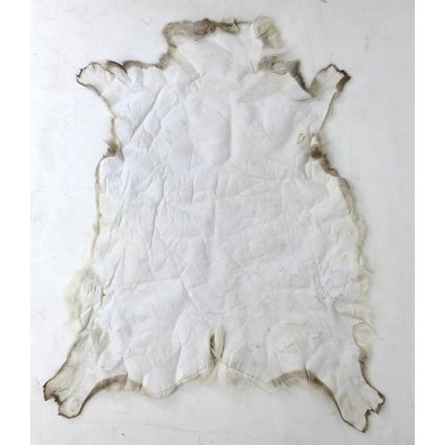 184 - A modern animal fur rug, 158 by 133cm....