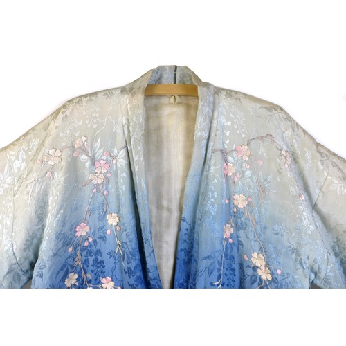 1 - An early 20th century Japanese haori padded jacket, embroidered in silk with white and pink flowered...