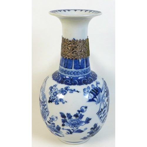 34 - A Chinese porcelain pouring vessel 'kendi' vase, Qing Dynasty, 18th century, with flared rim on a lo...