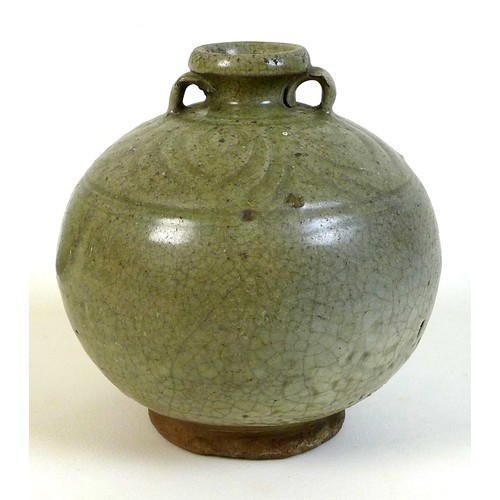 33 - A Chinese pottery celadon glaze two handled jar, probably Ming Dynasty, incised leaf form decoration...