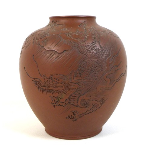 23 - A Chinese Yixing pottery vase, incised decoration to one side with a dragon descending from the clou...